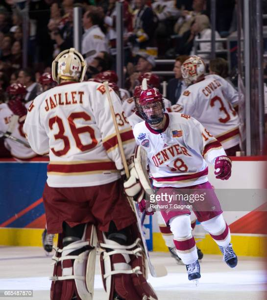 Emil Romig of the Denver Pioneers celebrates his goal against the Notre Dame Fighting Irish with teammate Tanner Jaillet during game two of the 2017...