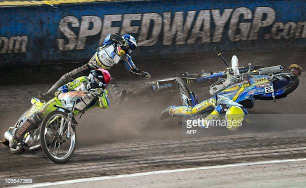 Emil Sayfutdinov of Russia and Tomasz Gollob of Poland take a spill behind Leigh Adams of Britain during the in the FIM Speedway Grand Prix of Sweden...