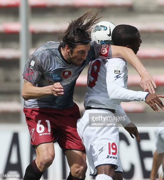 Emilaino Bonazzoli of Reggina competes for the ball in air with Kevin Vinetot of Crotone during the Serie B match between Reggina Calcio and FC...