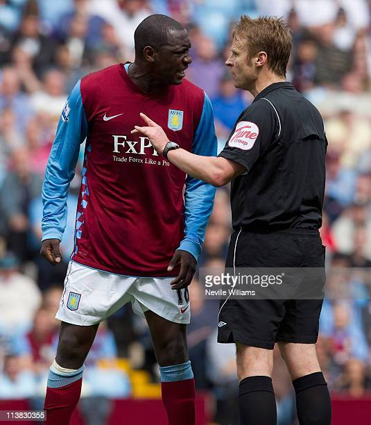 Emile Heskey of Aston Villa argues with referee Mike Jones during the Barclays Premier League match between Aston Villa and Wigan Athletic at Villa...