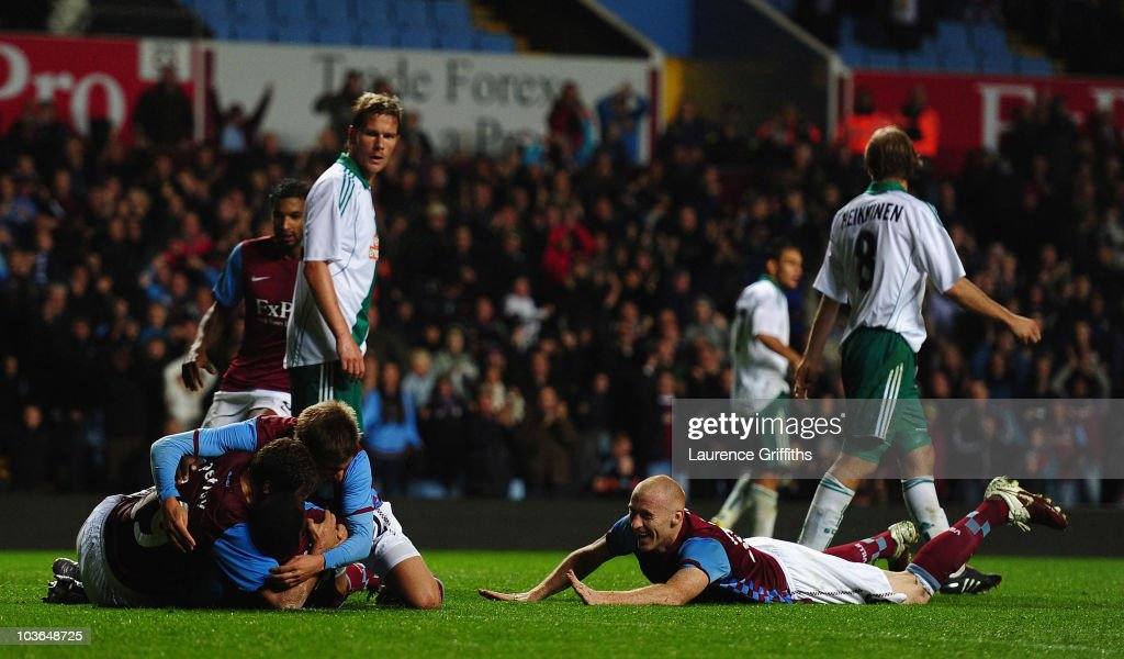 Emile Heskey of Aston Villa is mobbed after scoring the second goal during the UEFA Europa League play off second leg match between Aston Villa and SK Rapid Vienna at Villa Park on August 26, 2010 in Birmingham, England.