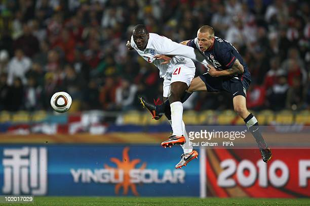 Emile Heskey of England and Jay Demerit of the United States in action during the 2010 FIFA World Cup South Africa Group C match between England and...