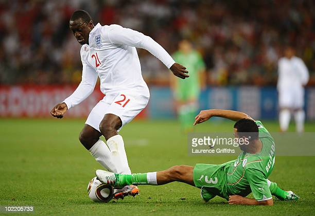 Emile Heskey of England is tackled by Nadir Belhadj of Algeria during the 2010 FIFA World Cup South Africa Group C match between England and Algeria...