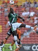 Emile Heskey of the Jets and Matthew Smith of the Roar challenge for the ball during the round 19 ALeague match between Brisbane Roar and the...