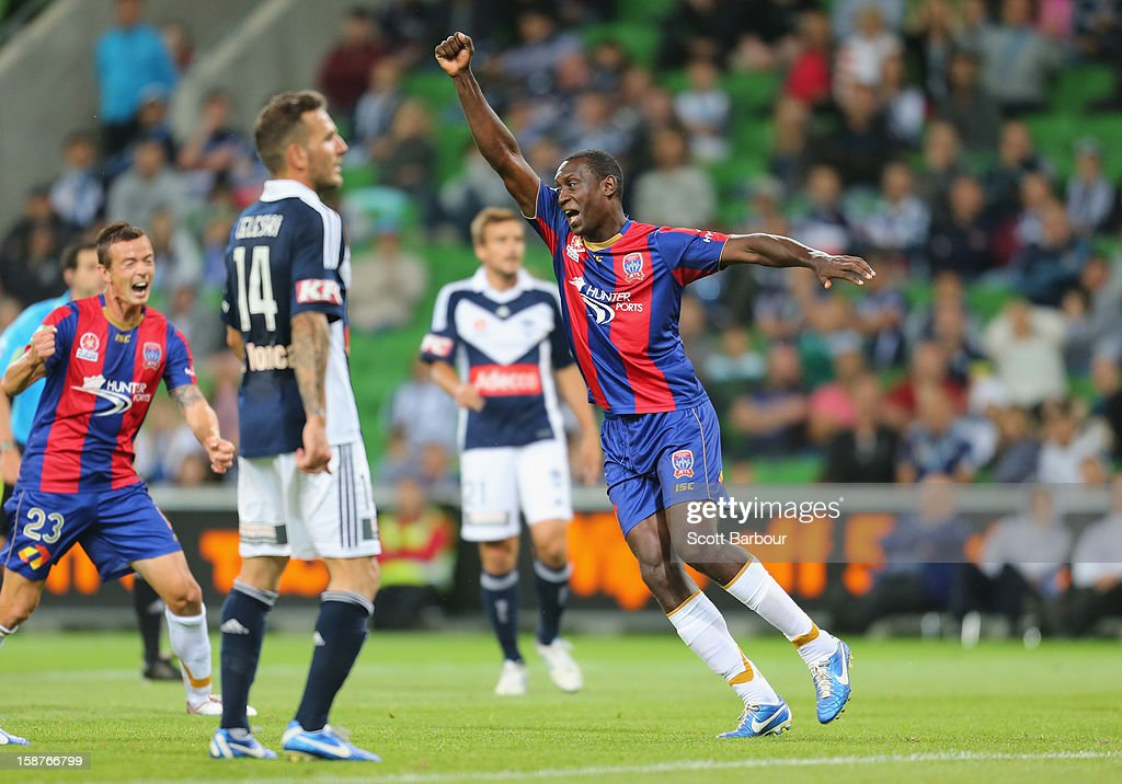 <a gi-track='captionPersonalityLinkClicked' href=/galleries/search?phrase=Emile+Heskey&family=editorial&specificpeople=204333 ng-click='$event.stopPropagation()'>Emile Heskey</a> of the Jets celebrates after scoring a goal during the round 13 A-League match between the Melbourne Victory and the Newcastle Jets at AAMI Park on December 28, 2012 in Melbourne, Australia.