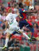 Emile Heskey of the Jets controls the ball in front of Jack Clisby of the Glory during the round 13 ALeague match between the Newcastle Jets and...