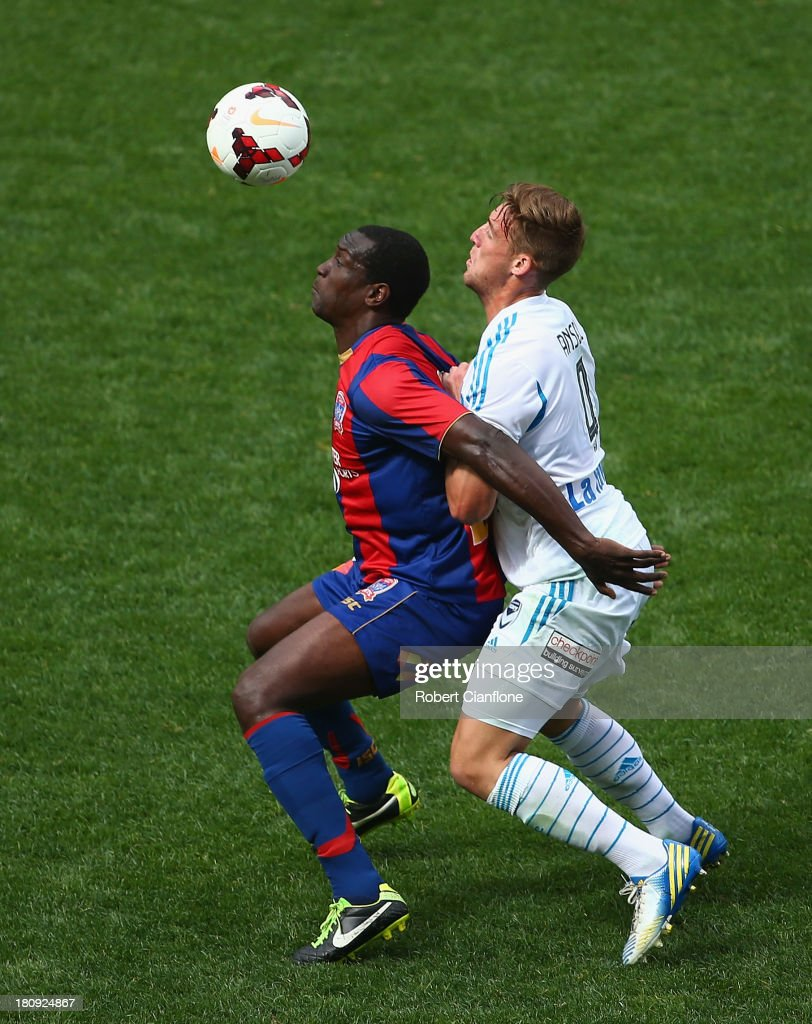 Emile Heskey of the Jets is is challenged by Nicholas Ansell of the Victory during the ALeague friendly match between the Melbourne Victory and the...