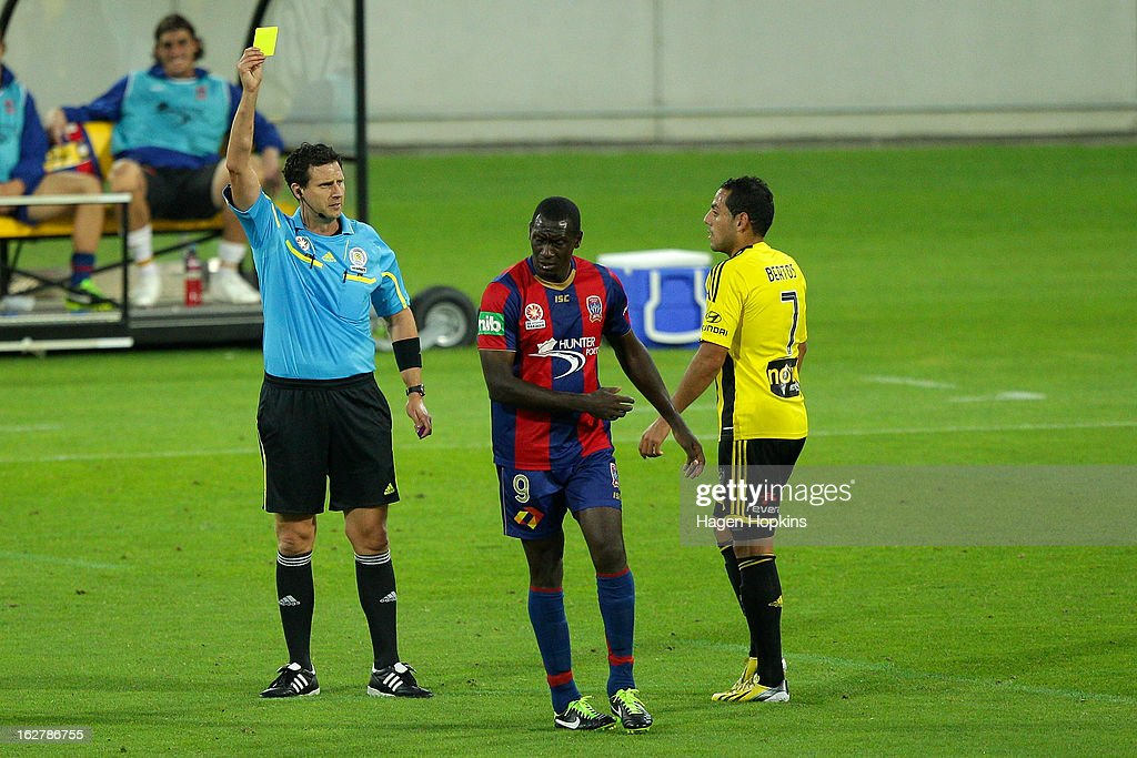 <a gi-track='captionPersonalityLinkClicked' href=/galleries/search?phrase=Emile+Heskey&family=editorial&specificpeople=204333 ng-click='$event.stopPropagation()'>Emile Heskey</a> of the Jets is shown a yellow card by referee Kris Griffiths-Jones during the round 26 A-League match between the Wellington Phoenix and the Newcastle Jets at Westpac Stadium on February 27, 2013 in Wellington, New Zealand.