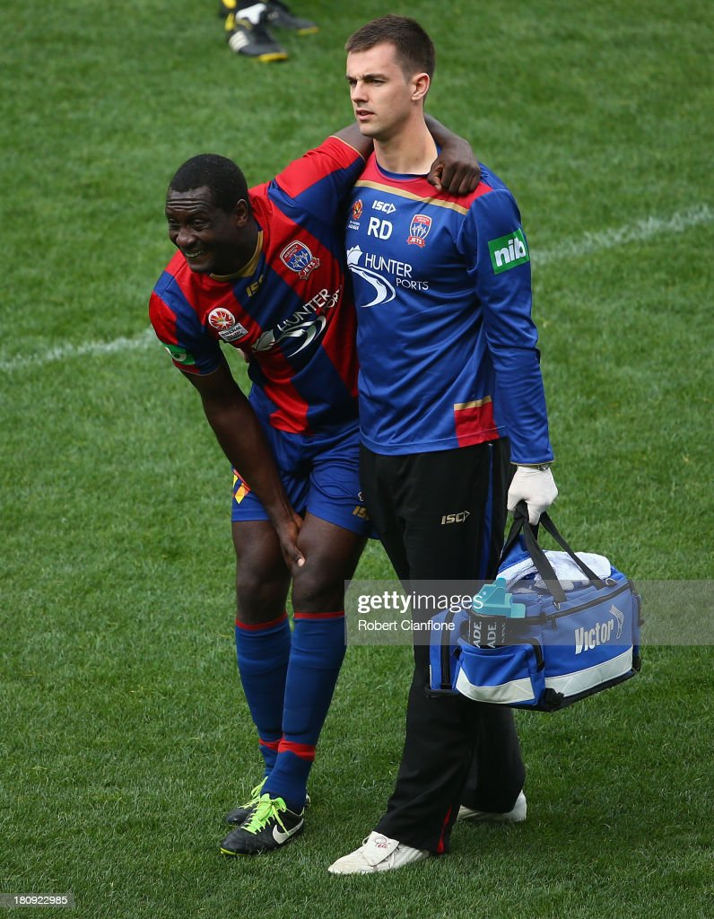 Emile Heskey of the Jets is taken from the ground with an injury during the ALeague friendly match between the Melbourne Victory and the Newcastle...