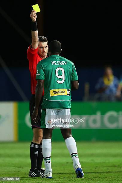 Emile Heskey of the Jets receives a yellow card from referee Jarred Gillett during the round 16 ALeague match between the Central Coast Mariners and...