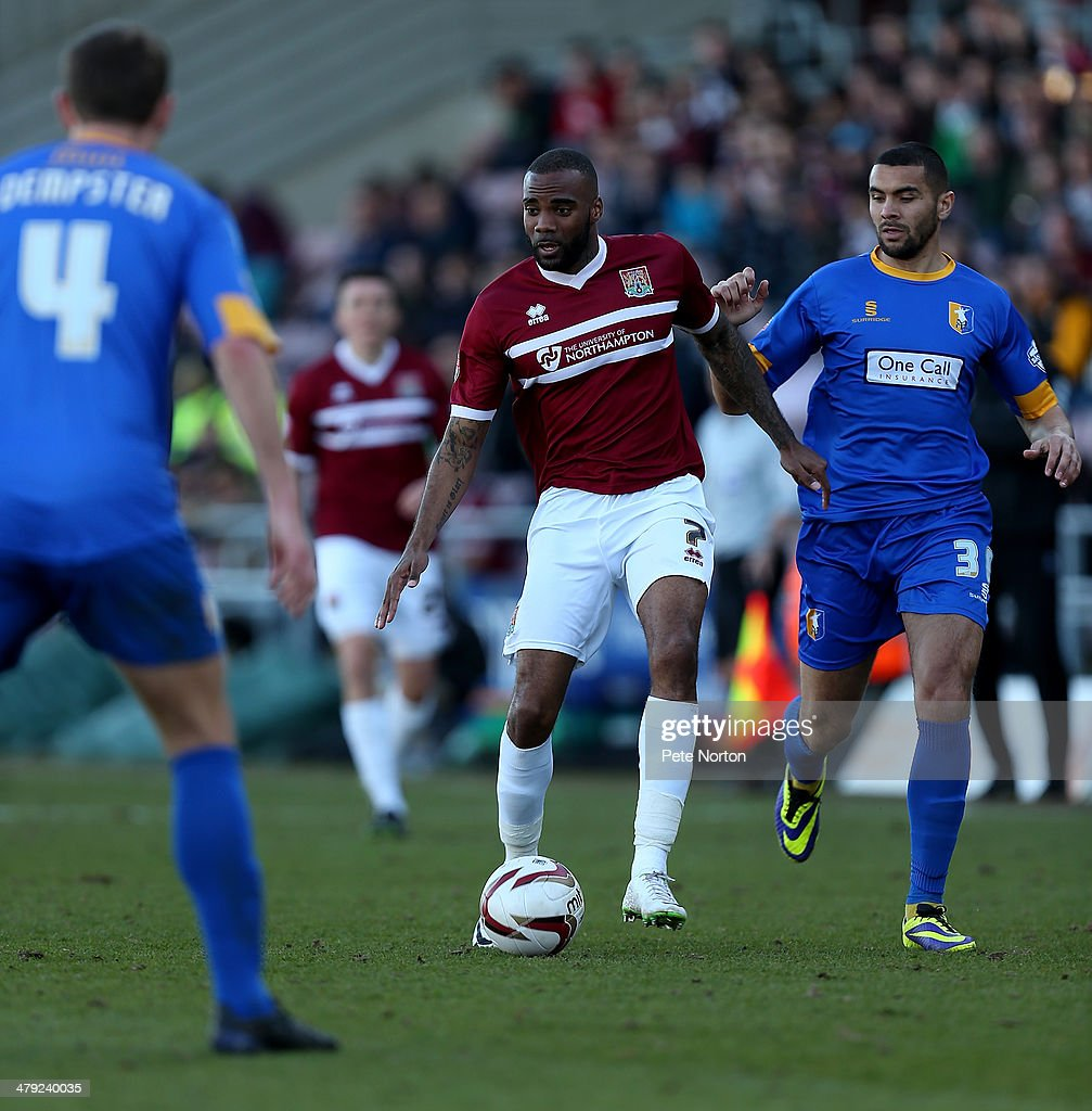 Emile Sinclair of Northampton Town moves forward with the ball during the Sky Bet League Two match between Northampton Town and Mansfield Town at Sixfields on March 15, 2014 in Northampton, England.