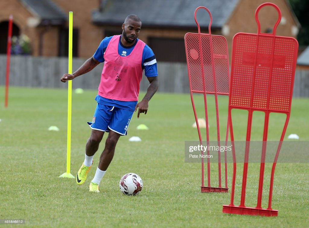 Emile Sinclair of Northampton Town moves with the ball during a training session at Moulton College on July 8, 2014 in Northampton, United Kingdom.