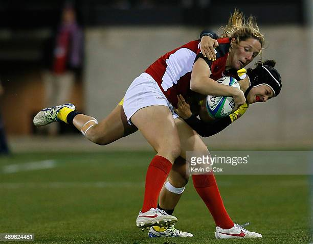 Emilee Cherry of Australia attempts to tackle Kelly Russell of Canada during the IRB Women's Sevens World Series at Fifth Third Bank Stadium on...