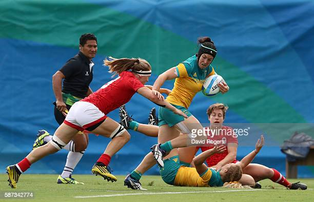 Emilee Cherry of Australia breaks through to score Australia try during the Women's Semi Final 1 Rugby Sevens match between Australia and Canada on...