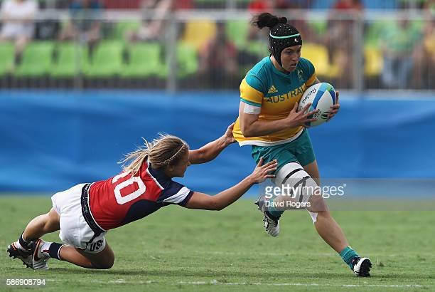 Emilee Cherry of Australia carries the ball under pressure against Richelle Stephens of the United States during the Women's Pool A rugby match on...