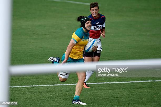 Emilee Cherry of Australia runs ahead of Jessica Javelet of the United States during their 1212 rugby sevens tie at Rio 2016 on Sunday August 7 2016