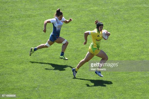 Emilee Cherry of Australia runs with the ball during the HSBC World Rugby Women's Sevens Series 2016/17 Kitakyushu quarter final between Australia...
