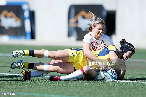 Emilee Cherry of Australia scores a try against Abigail Chamberlain of England during the Women's Sevens World Series at Fifth Third Bank Stadium on...