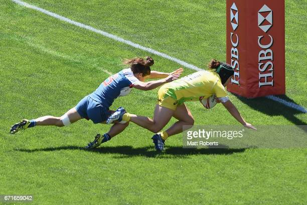 Emilee Cherry of Australia scores a try during the HSBC World Rugby Women's Sevens Series 2016/17 Kitakyushu quarter final between Australia and...