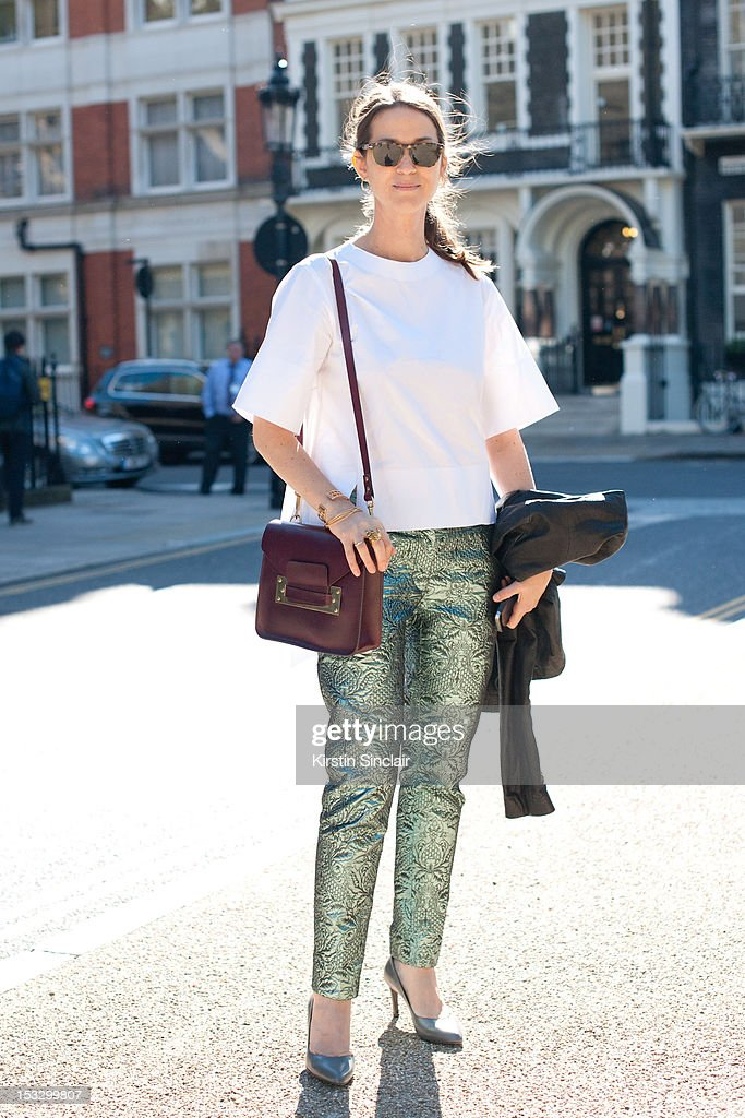 Emiley Zak executive retail editor at British Vogue wearing Jonathan Saunders shoes, Miu Miu trousers, Celine top, Sophie Hulme bag and Persol Sunglasses on day 5 of London Fashion Week Spring/Summer 2013, on September 18, 2012 in London, England.