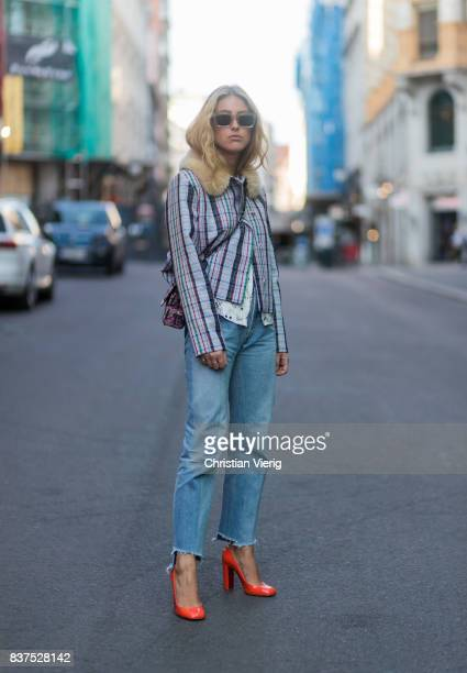 Emili Sindlev wearing jacket with collar cropped denim jeans outside Line of Oslo on August 22 2017 in Oslo Norway
