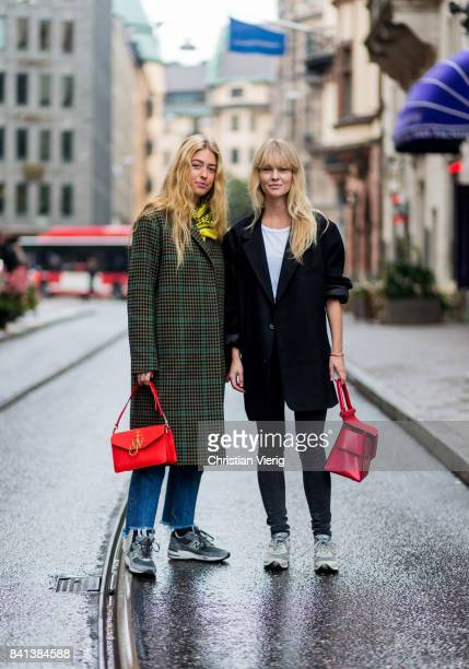 Emili Sindlev wearing olive checked wool coat red JW Anderson bag and Jeanette Madsen on August 31 2017 in Stockholm Sweden
