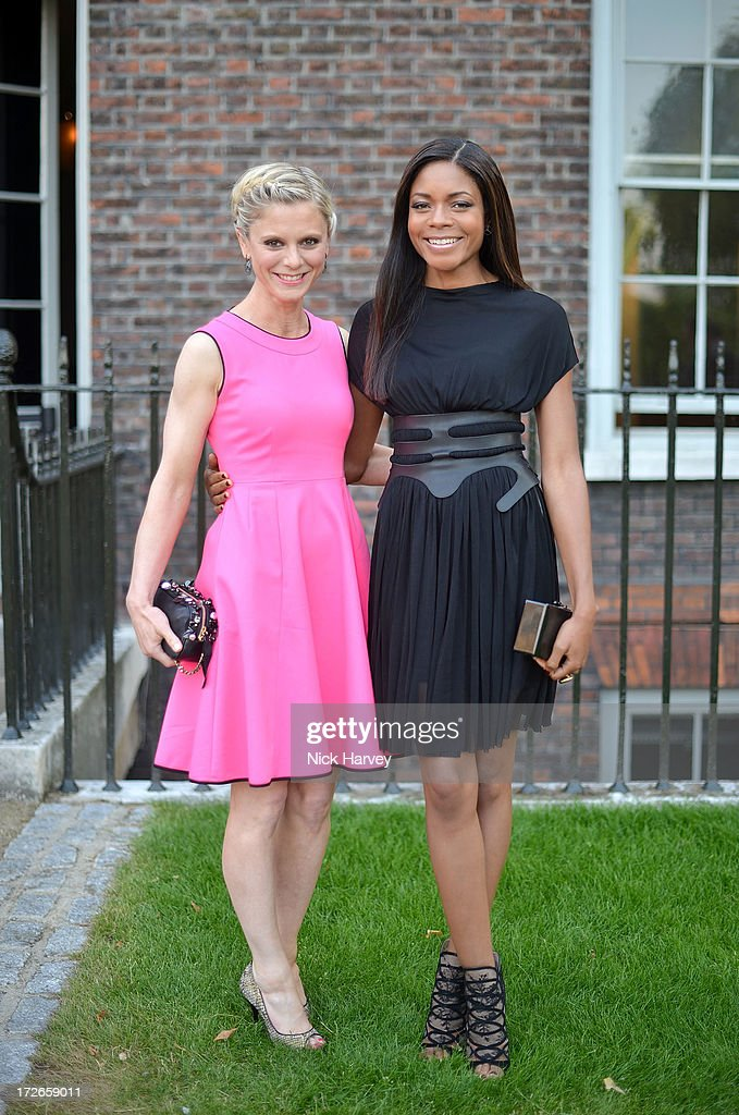 Emilia Fox and Naomie Harris attends the launch party for the Fashion Rules exhibition, a collection of dresses worn by HRH Queen Elizabeth II, Princess Margaret and Diana, Princess of Wales at Kensington Palace on July 4, 2013 in London, England.