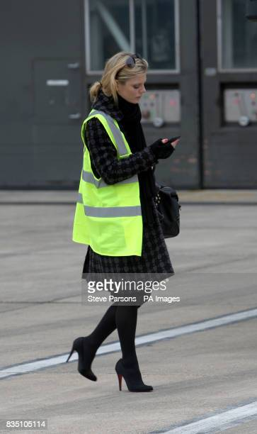 Emilia Fox waits for partner Jeremy Gilley at the British Airways Engineering Base at Heathrow Airport