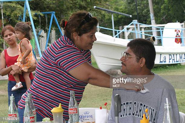 Emilia Hernandez helps her husband Francisco Ruiz during a rare family outing at a park in Tampico Mexico Ruiz was partly paralyzed and brain damaged...
