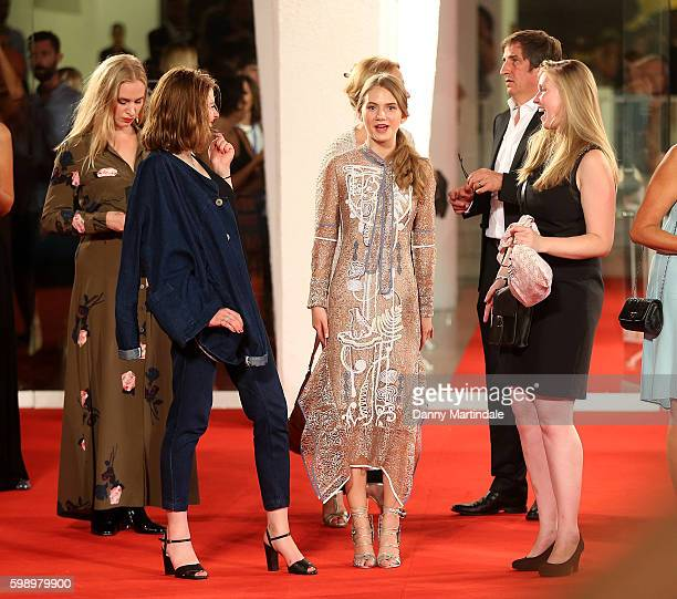 Emilia Jones has a joke with friends on the red carpet during the premiere of 'Brimstone' during the 73rd Venice Film Festival at on September 3 2016...
