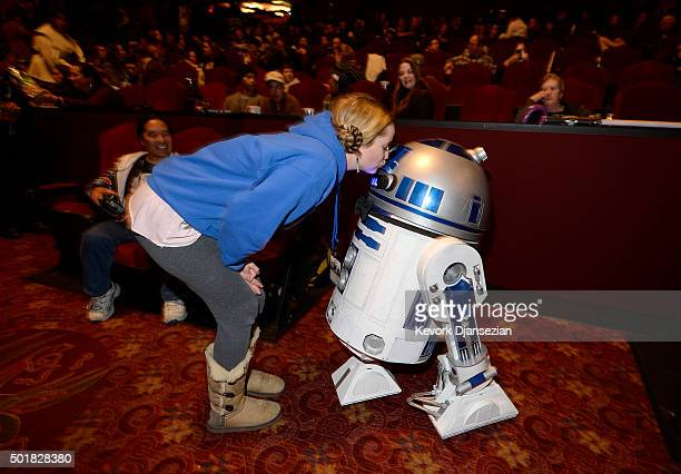 Emilia Lindgren kisses R2D2 during the opening night of Walt Disney Pictures and Lucasfilm's 'Star Wars The Force Awakens' at TCL Chinese Theatre on...