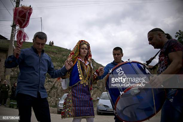 Emilia Pechinkova a 24yearsold Bulgarian Pomak bride dances with her father father Mili Perchikov during her threeday wedding ceremony in the village...