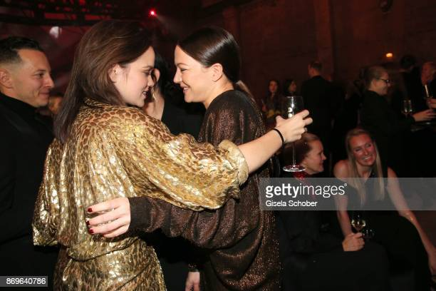 Emilia Schuele and Hannah Herzsprung during the 'When the Ordinary becomes Precious #CartierParty Berlin' at Old Power Station on November 2 2017 in...