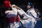 Emiliana Machado of Venezuela competes against Ekaterina Puliana of Russia during a woman's 74kg combat as part of WTF World Taekwondo Championships...