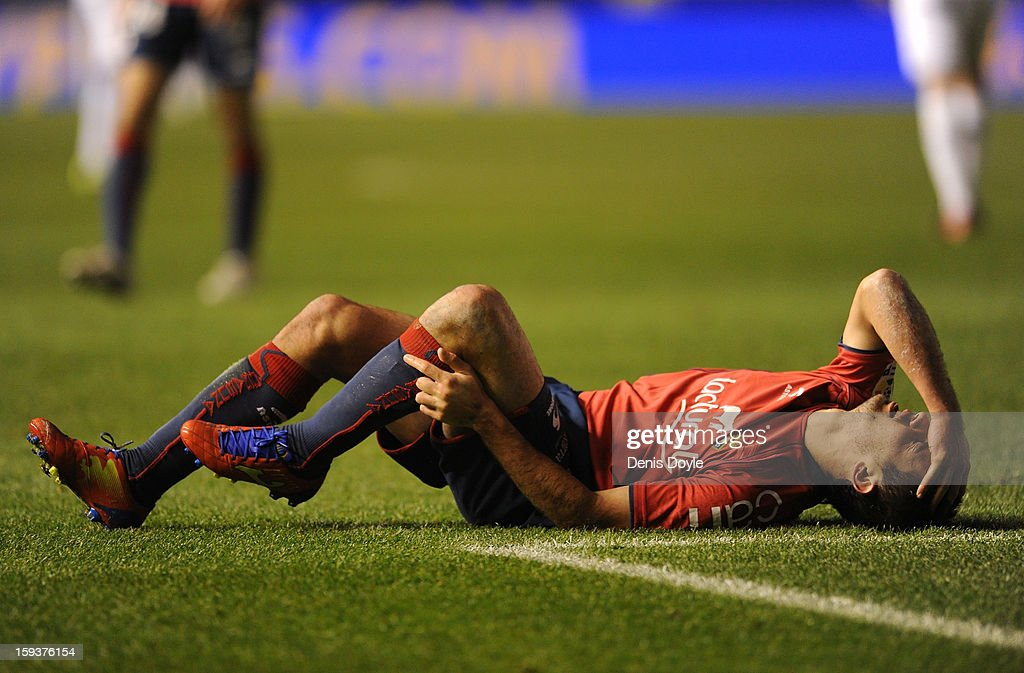 Emiliano Armenteros of Osasuna reacts after taking a knock during the La Liga match between Osasuna and Real Madrid at estadio Reino de Navarra on January 12, 2013 in Pamplona, Spain.