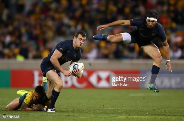 Emiliano Boffelli of Argentina is tackled as Matias Orlando of Argentina leaps into the air during The Rugby Championship match between the...