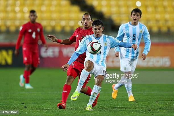 Emiliano Buendia of Argentina plays the ball under pressure from Jesus Gonzalez of Panama during the Group B FIFA U20 World Cup New Zealand 2015...