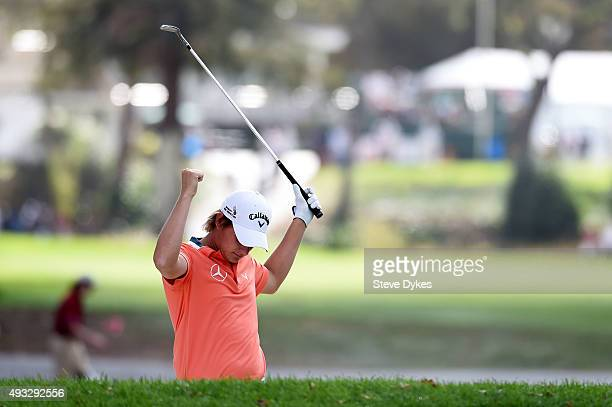 Emiliano Grillo of Argentina celebrates a shot from a bunker on the tenth hole during final round of the Fryscom Open on October 18 2015 at the North...