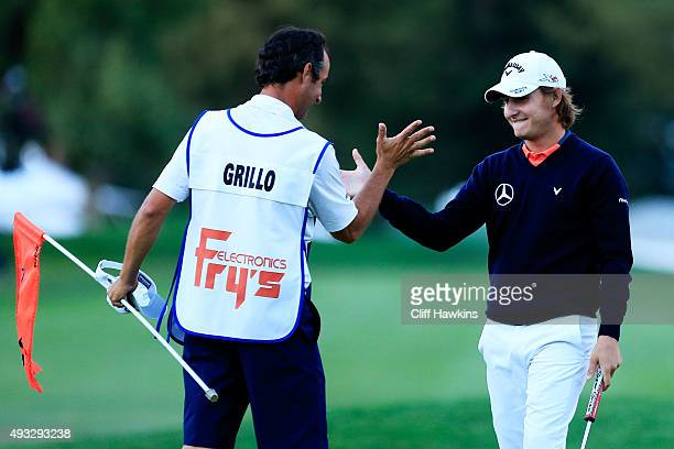 Emiliano Grillo of Argentina celebrates with his caddie Jose Luis Campras after winning in the final round of the Fryscom Open on October 18 2015 at...