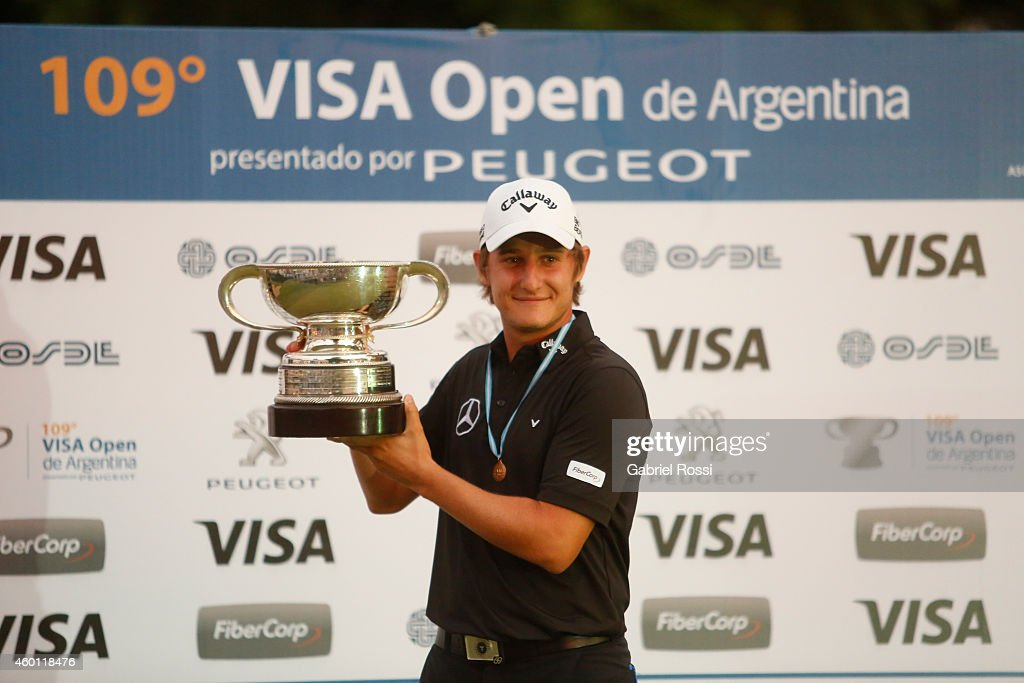 Emiliano Grillo of Argentina celebrates with the trophy after the closing day of the 109th VISA Open Argentina as part of PGA Latinoamerica tour at Martindale Country Club on December 07, 2014 in Buenos Aires, Argentina.