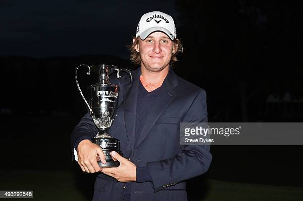Emiliano Grillo of Argentina celebrates with the trophy after winning in the final round of the Fryscom Open on October 18 2015 at the North Course...