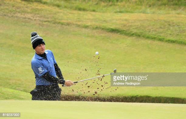 Emiliano Grillo of Argentina hits his second shot from a bunker on the 7th during the first round of the 146th Open Championship at Royal Birkdale on...