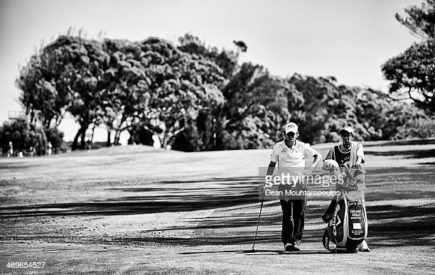 Emiliano Grillo of Argentina lines up a putt on the 15th green during Day 3 of the Africa Open at East London Golf Club on February 15 2014 in East...