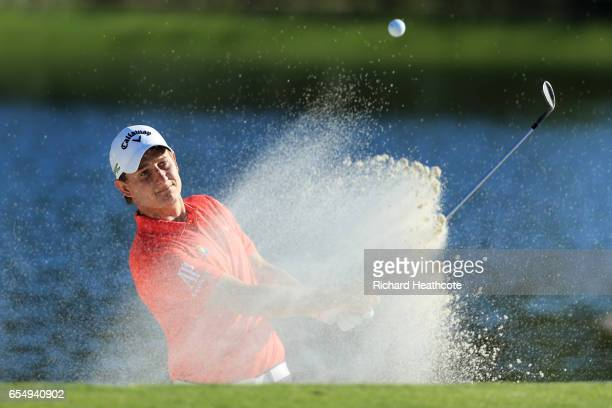 Emiliano Grillo of Argentina plays a shot from a bunker on the 17th hole during the third round of the Arnold Palmer Invitational Presented By...