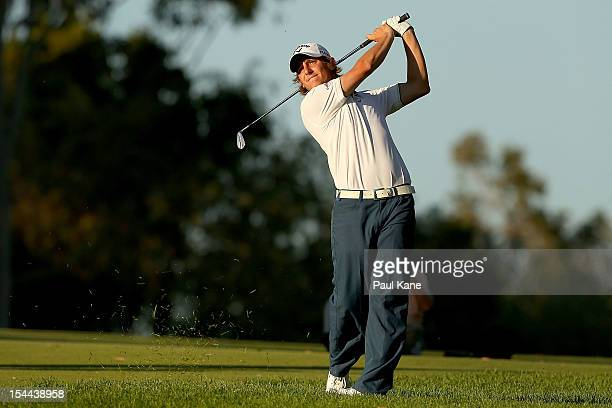 Emiliano Grillo of Argentina plays his approach shot on the 18th hole during round three of the Perth International at Lake Karrinyup Country Club on...