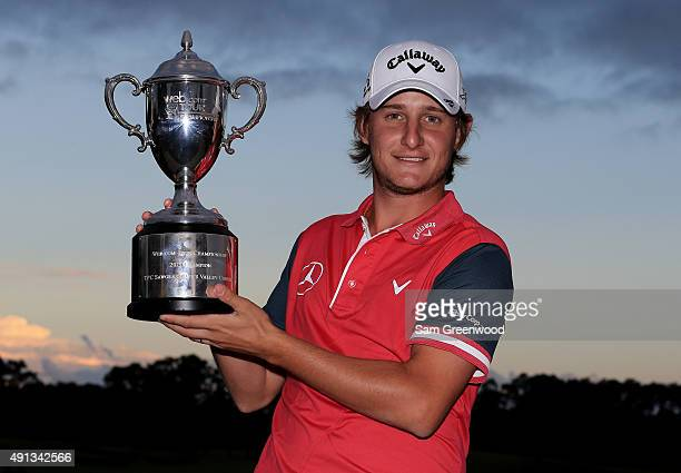 Emiliano Grillo of Argentina poses with the trophy after winning the Webcom Tour Championship at the TPC Sawgrass Dye's Valley Course on October 4...