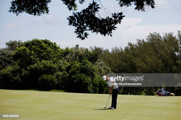 Emiliano Grillo of Argentina putts on the 6th green during Day 3 of the Africa Open at East London Golf Club on February 15 2014 in East London South...