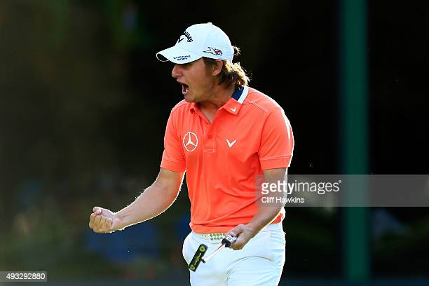 Emiliano Grillo of Argentina reacts after putting on the 18th green to take the lead prior to winning against Kevin Na in a playoff during final...