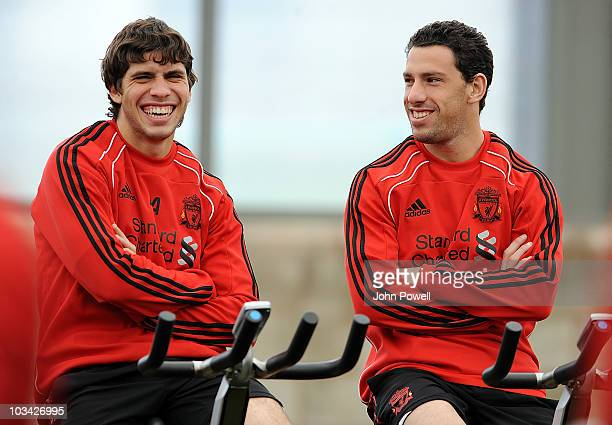 Emiliano Insua and Maxi Rodriguez of Liverpool smile during a training session at Melwood training ground on August 18 2010 in Liverpool England