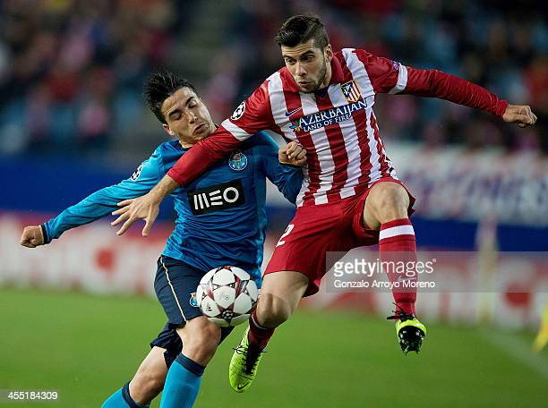 Emiliano Insua of Atletico de Madrid competes for the ball with Josue Pesqueira of FC Porto during the UEFA Champions League Group G match at Vicente...